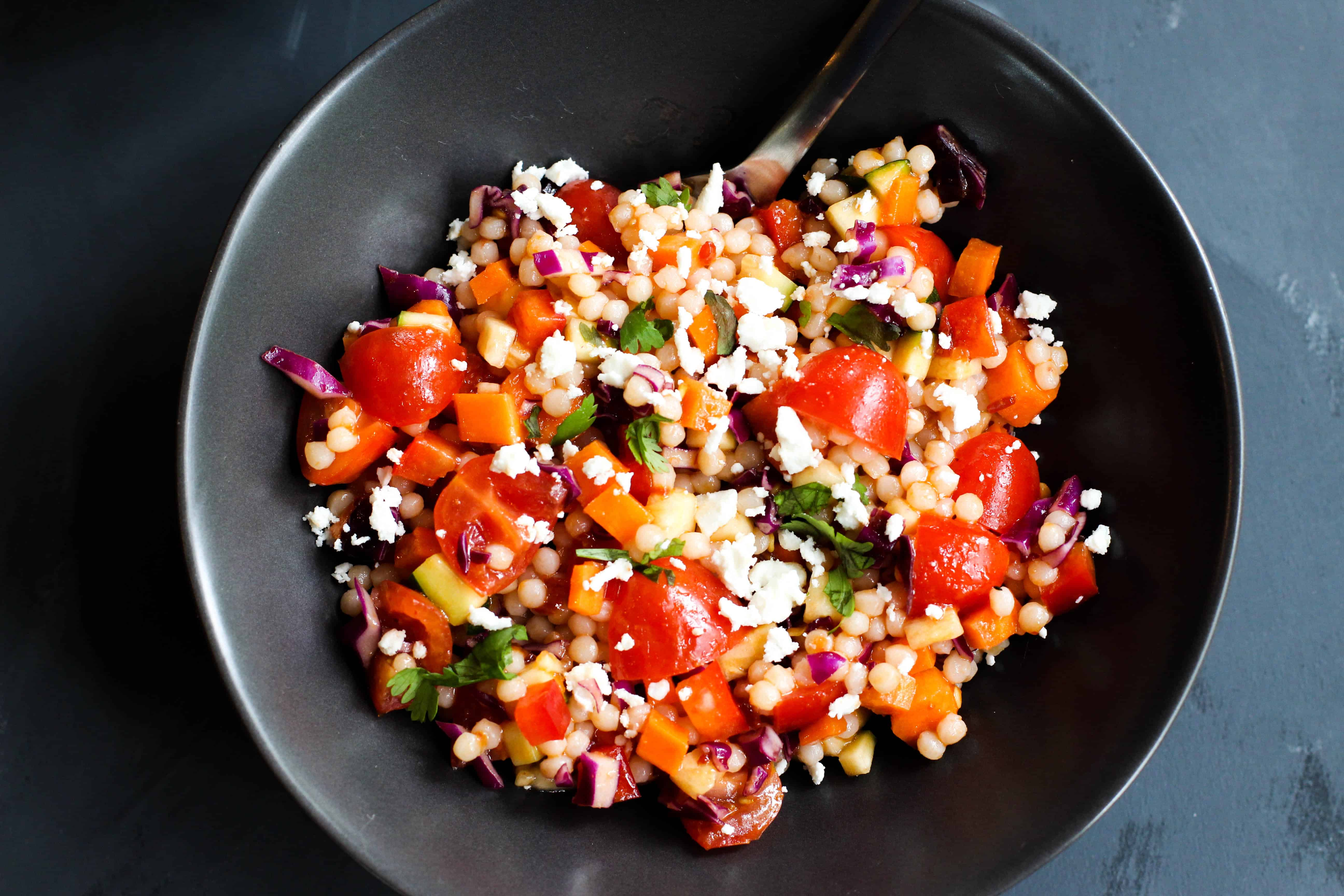 This Spicy Israeli Couscous Salad is easy to throw together and so vibrant in colors and flavors!