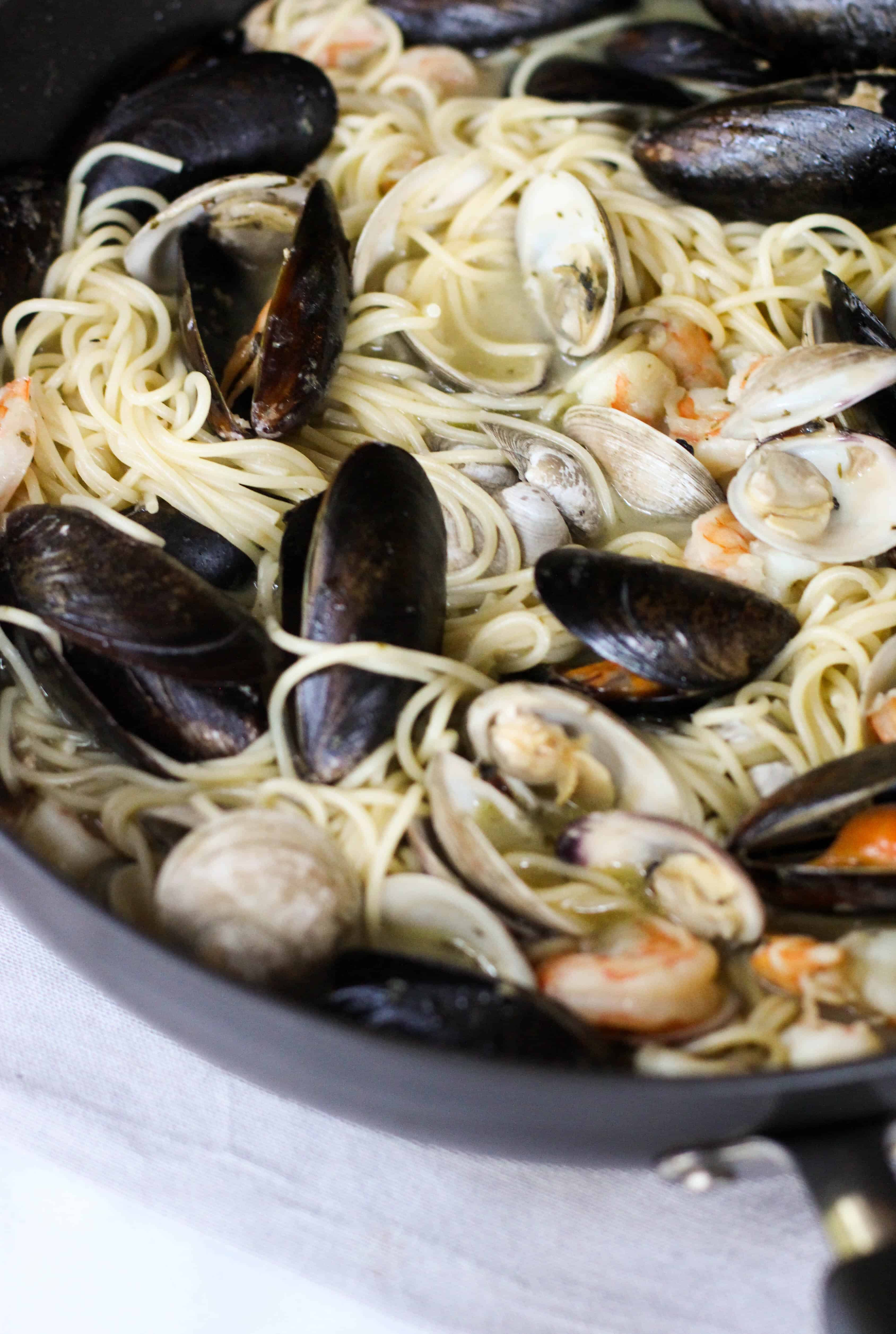 This Easy Seafood Pasta with White Wine Butter Sauce is quick enough for a week night, but still great to impress your guests!