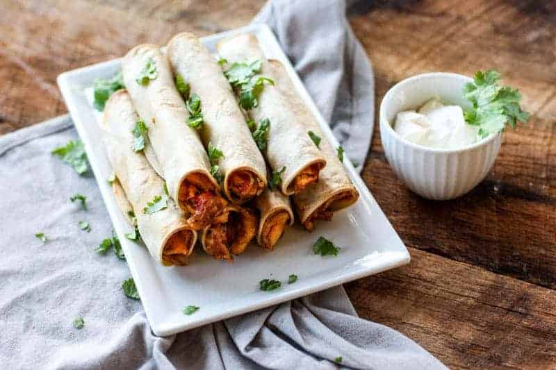 These Baked Chicken Taquitos are full of flavor and make for a great snack or appetizer!