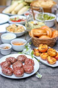 These Aussie Grass Fed Beef Burgers with Grilled Peaches and Chipotle Onion Jam are layered with bold flavors and perfect for the adventurous eater!