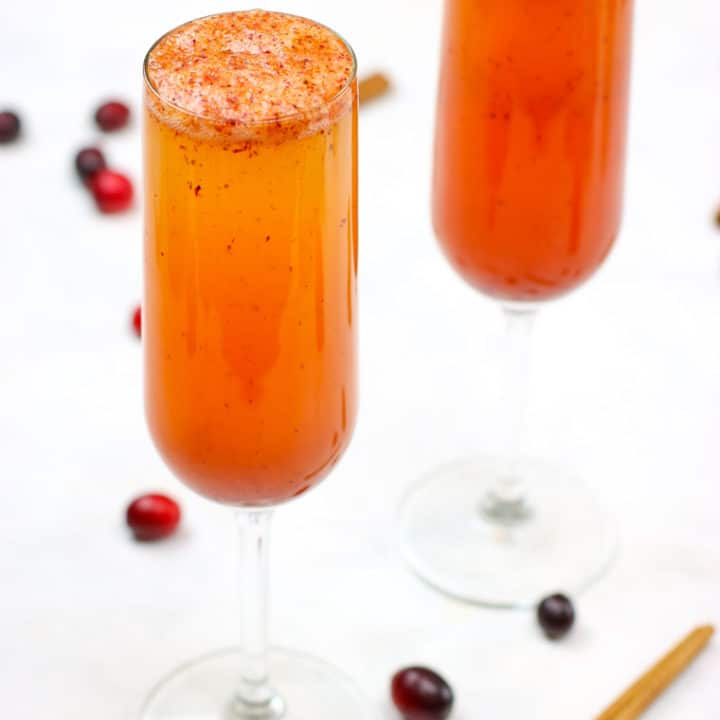 These Spiced Cranberry Cider Mimosas are perfect for your holiday festivities!