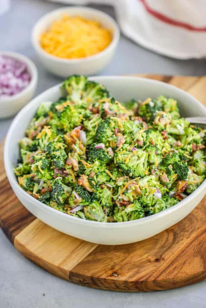 This easy Broccoli Salad with Bacon will become a classic for all of your potlucks and tailgates with just a few ingredients needed to bring it together.