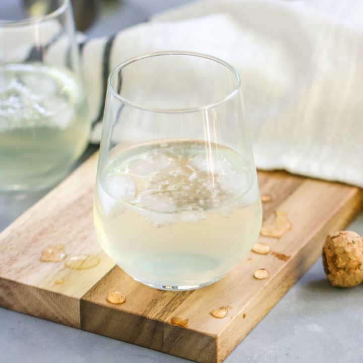 This Sparkling Elderflower Lemonade will quickly become your favorite drink of summer! It's an adult floral lemonade topped with champagne. What's not to love?