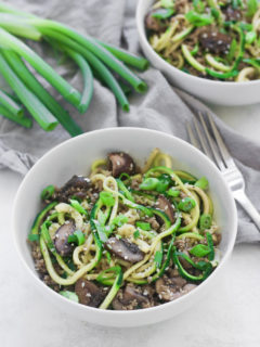 two bowls of sesame zoodles with ground turkey
