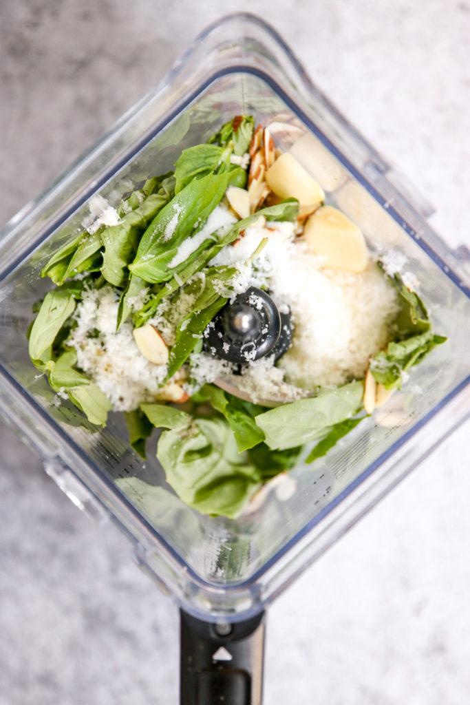 basil, parmesan, garlic, and almond in a blender