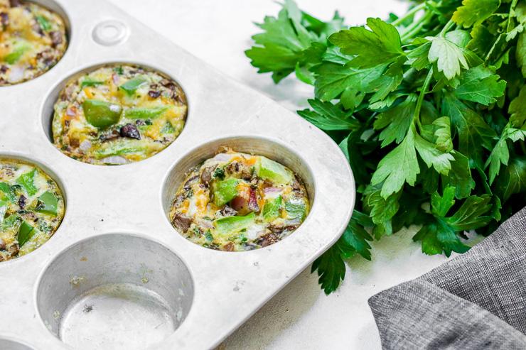 a veggie egg muffin in a muffin tin