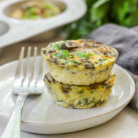 a close up of two veggie egg muffins