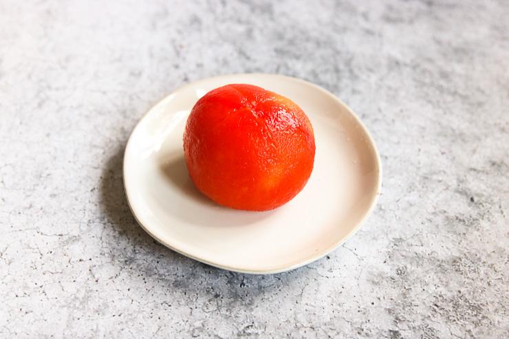 a peeled tomato on a plate
