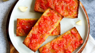 a plate of sliced pan con tomate