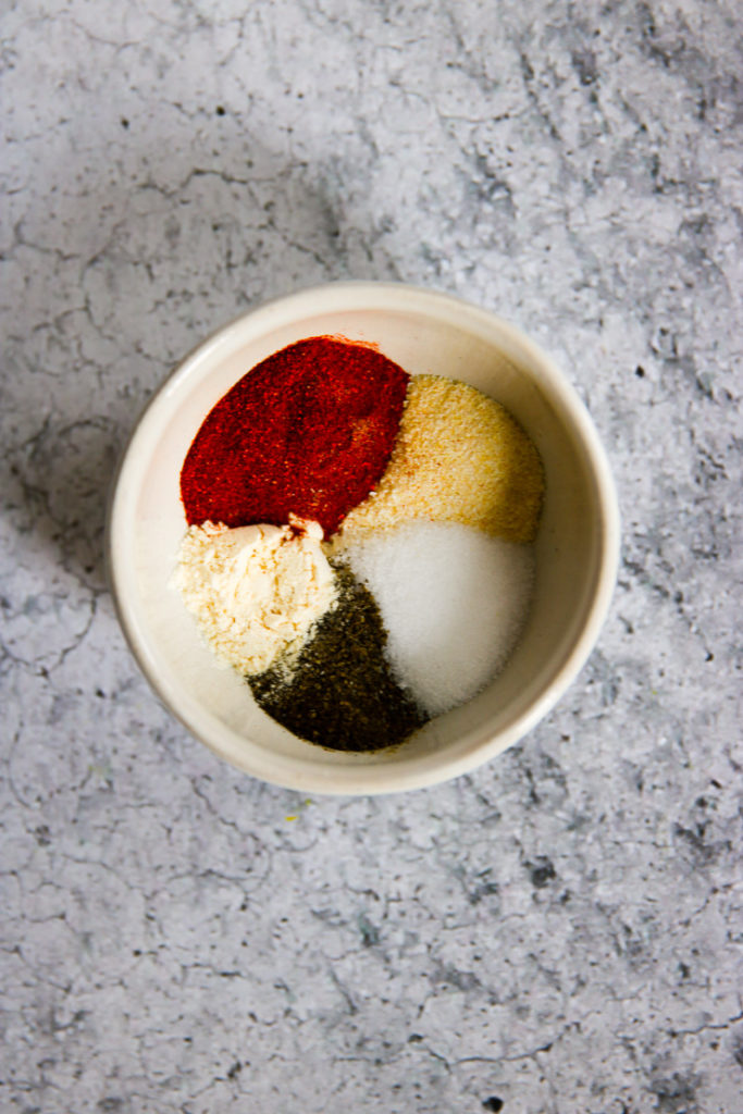 An overhead shot of a seasoning blend in a white bowl