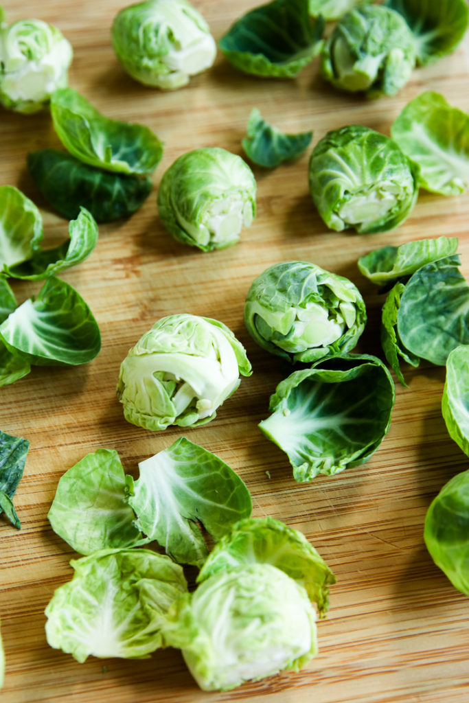 Brussels Sprouts on a wooden cutting board