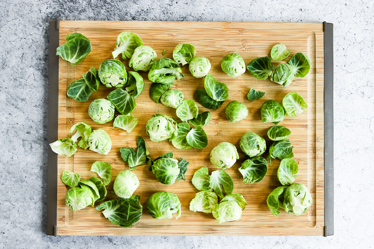 peeled leaves off of the brussels sprouts on a cutting board