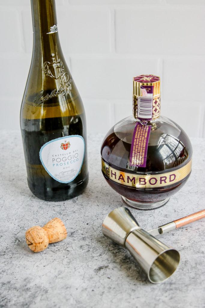 prosecco bottle, cork, chambord bottle, and jigger