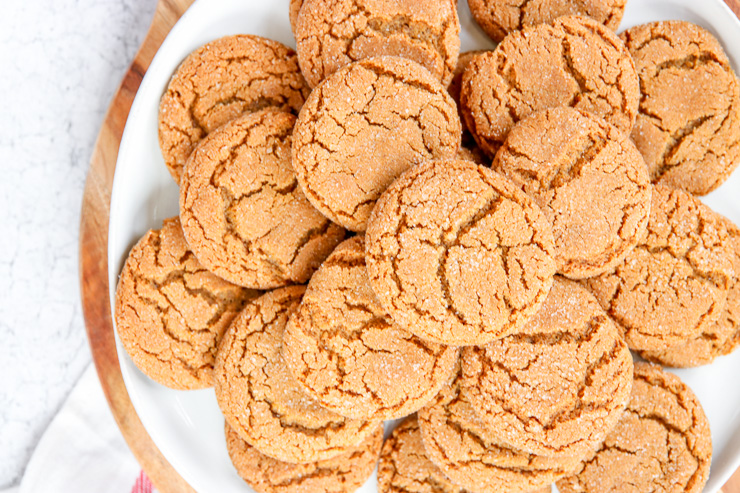 a plate of ginger snaps piled on top of one another