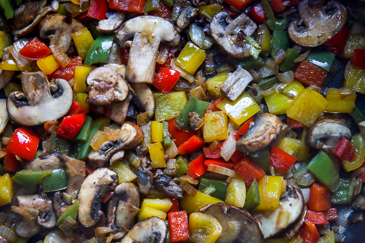 a close up image of mushrooms, onions, and peppers