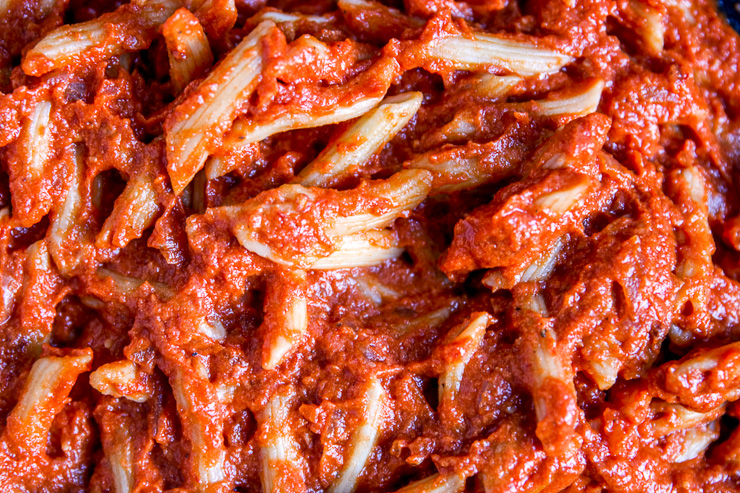a close up of penne in vodka sauce