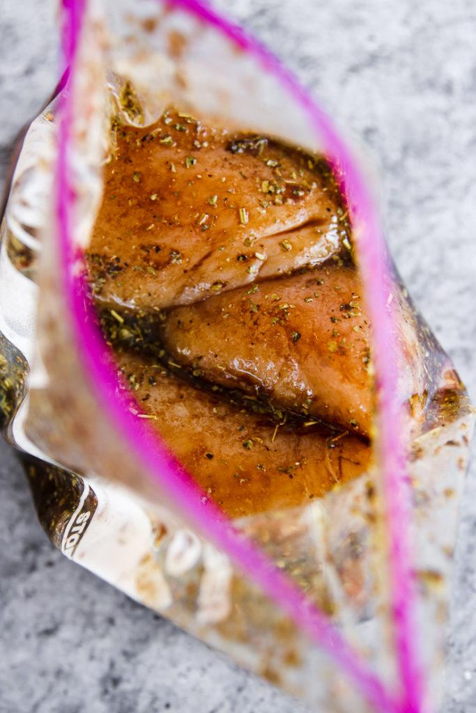 a ziplock of chicken breasts and balsamic marinade