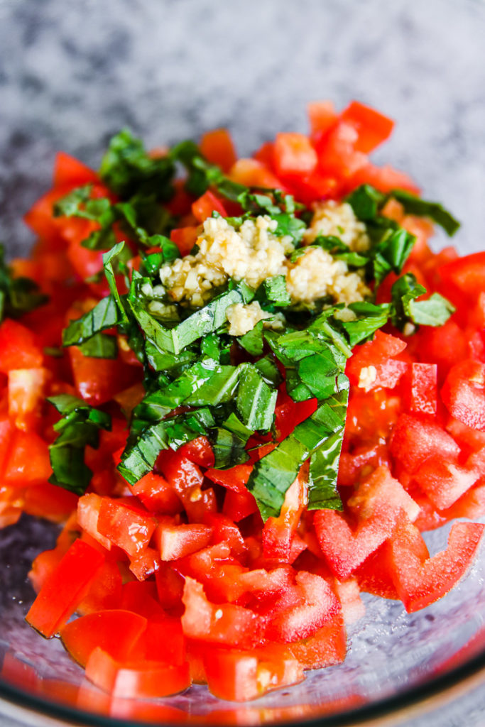 diced tomatoes with chopped basil and minced garlic on top