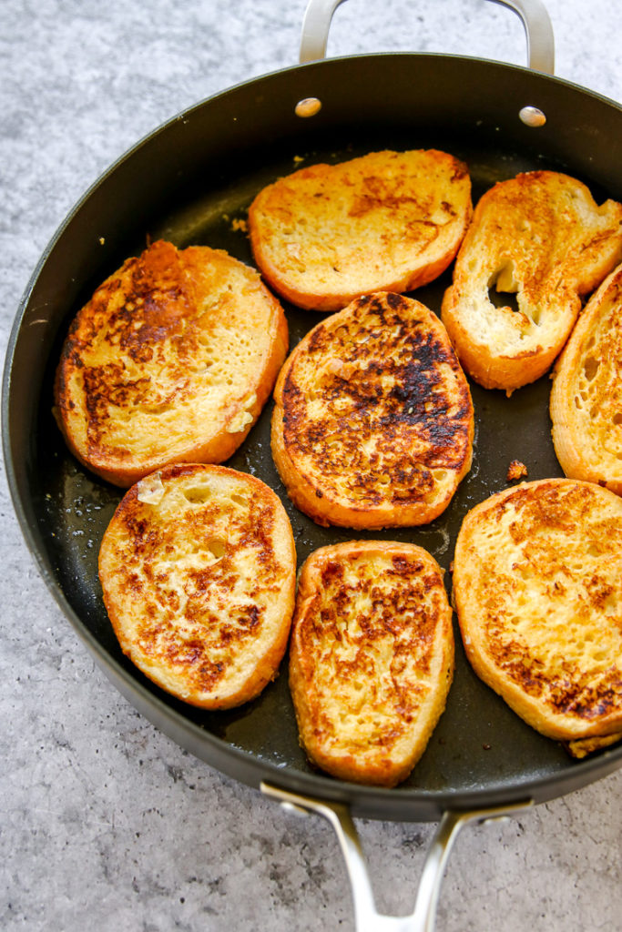a skillet of browned french toast slices