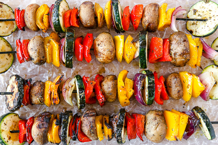 a closeup of grilled veggies on skewers