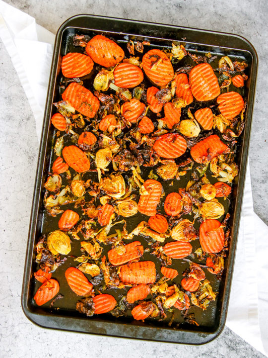 a sheet pan full of roasted brussels sprouts and carrots