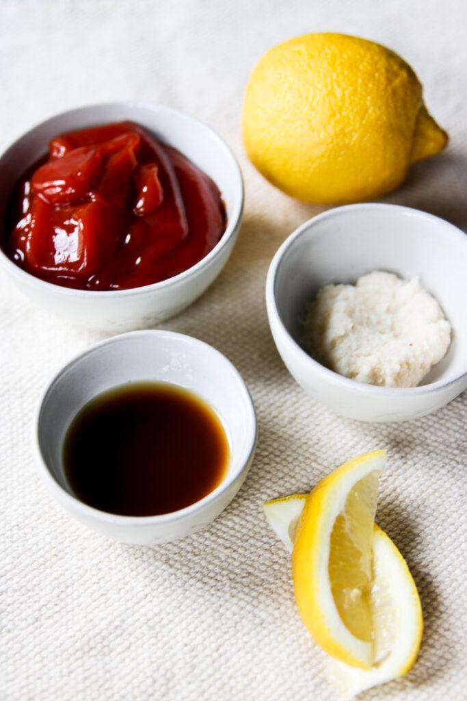 bowls of ketchup, prepared horseradish, Worcestershire sauce, and lemon juice