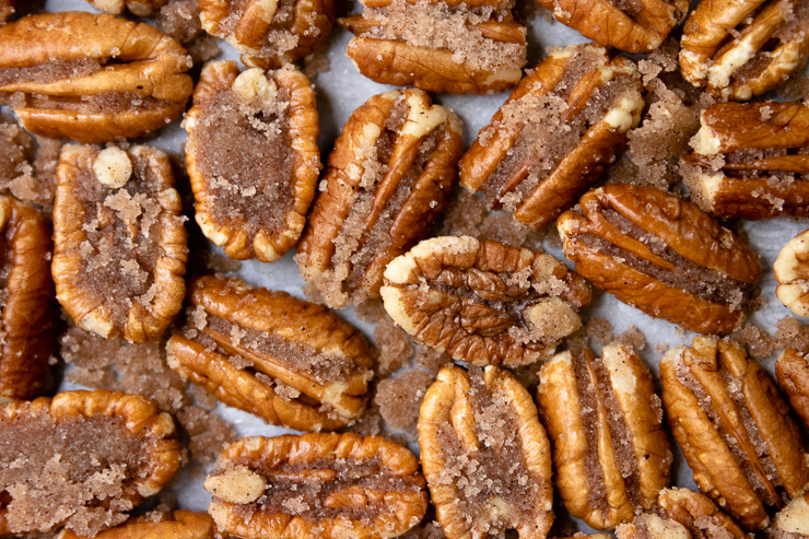 a close up of candied pecan halves